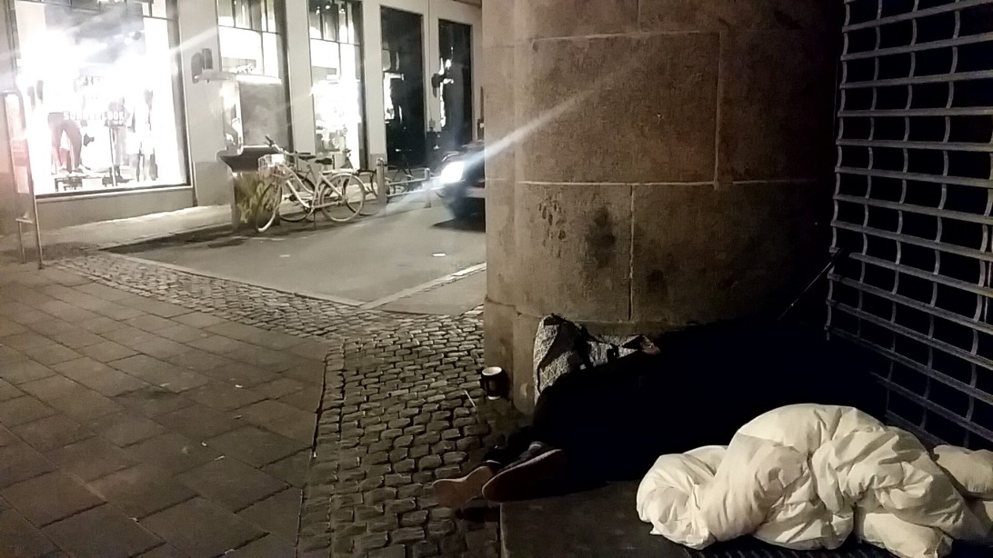 Homeless sleeping in a corner of the street
