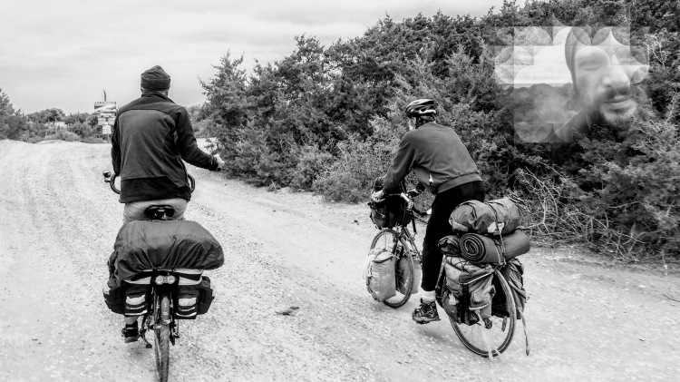 Two men on two bicycles bike touring in the nature
