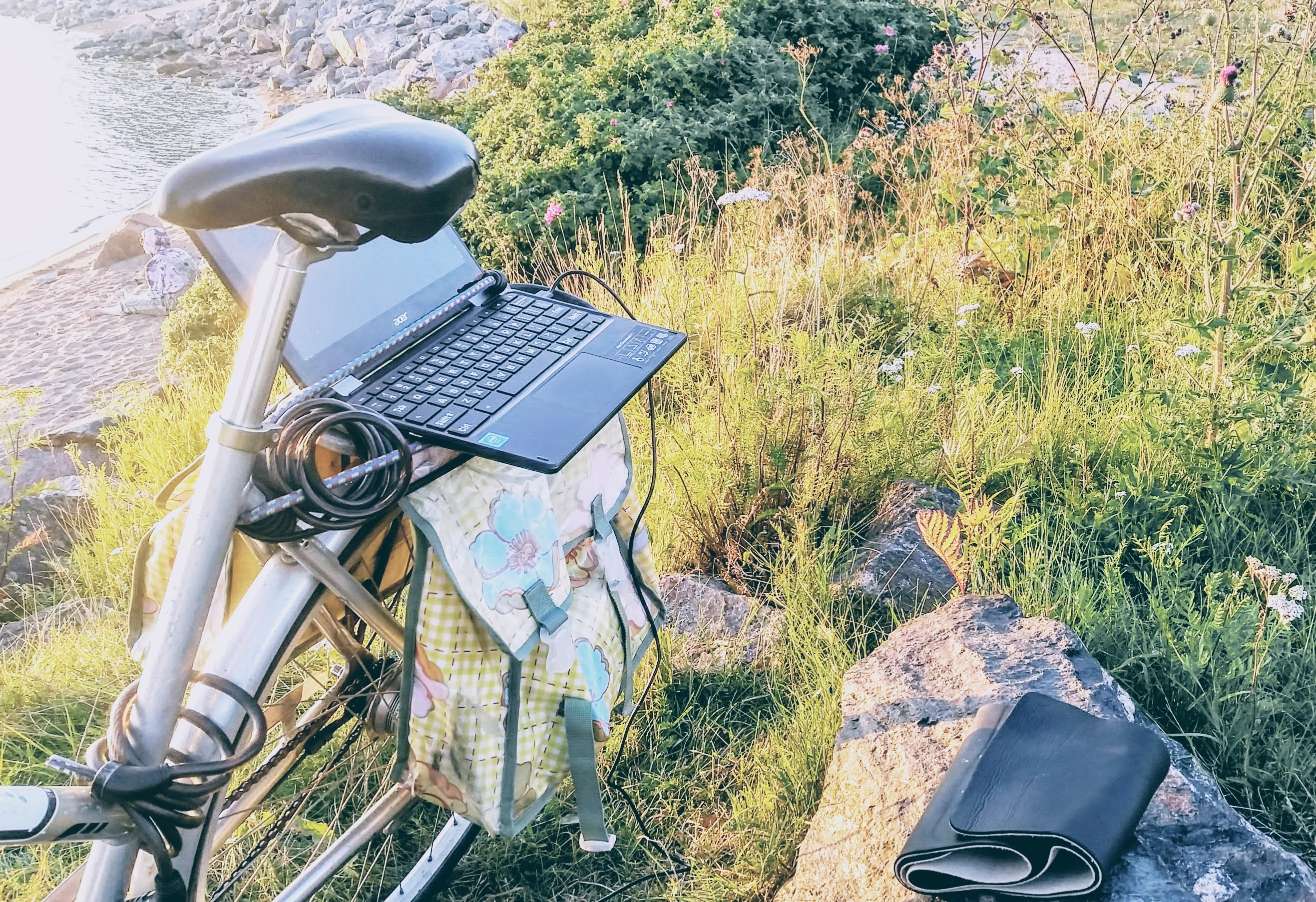 A laptop on the back rack of a bicycle, used as desk