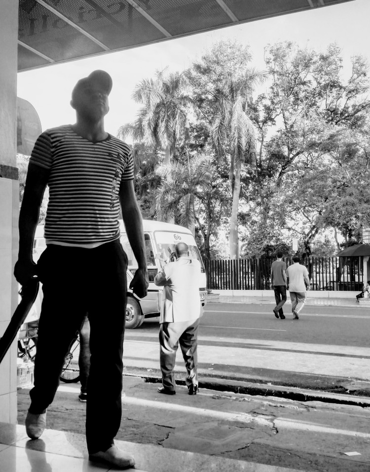 A man walking with a gun in the Santo Domingo